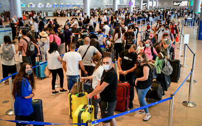 Travelers seen in the departure hall at the Ben Gurion International Airport, on July 19, 2021. (Avshalom Sassoni/Flash90)