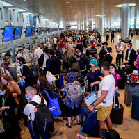 Travellers seen in the departure hall at the Ben Gurion International Airport, on July 19, 2021. (Avshalom Sassoni/Flash90)