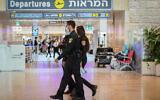 Police officers enforce COVID-19 regulations at Ben Gurion Airport, on July 19, 2021. (Avshalom Sassoni/Flash90)