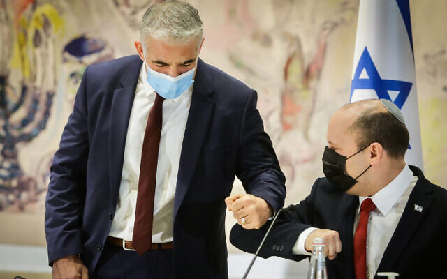 Foreign Minister Yair Lapid and Prime Minister Naftali Bennett at a cabinet meeting at the Knesset, on July 19, 2021.  (Marc Israel Sellem/Pool)