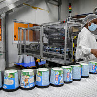 Workers at the Ben and Jerry's factory near Kiryat Malakhi, on July 21, 2021. (Flash90)