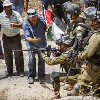 Palestinians clash with Israeli security forces during a protest in the  northern West Bank on July 23, 2021. (Nasser Ishtayeh/Flash90)