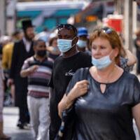 People walk on Jaffa Street in Jerusalem, July 25, 2021 (Olivier Fitoussi/Flash90)