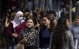 People, some wearing face masks, walk on Jaffa Street in Jerusalem, July 25, 2021. (Olivier Fitoussi/Flash90)