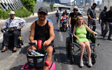 Disabled activists block the Ayalon Highway in Tel Aviv on July 25, 2021. (Tomer Neuberg/Flash90)