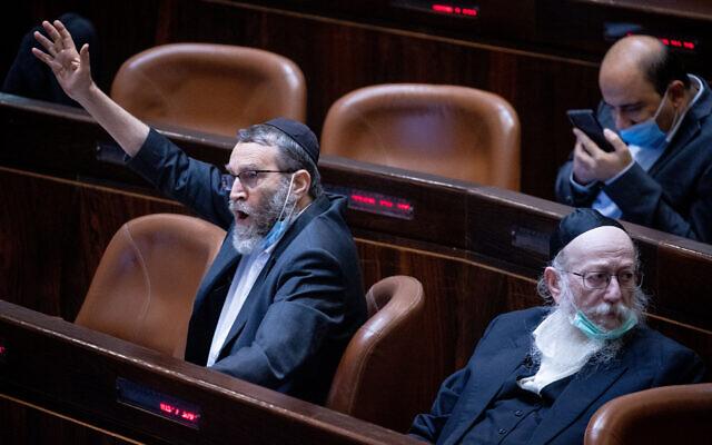 United Torah Judaism MK Moshe Gafni (L) in the Knesset plenum on July 26, 2021. (Yonatan Sindel/Flash90)