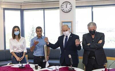 Prime Minister Naftali Bennett, Social Equality Minister Meirav Cohen (L) and Labor and Welfare Minister Meir Cohen (R) visit a retirement home in Jerusalem, July 27, 2021. (Olivier Fitoussi/Flash90)
