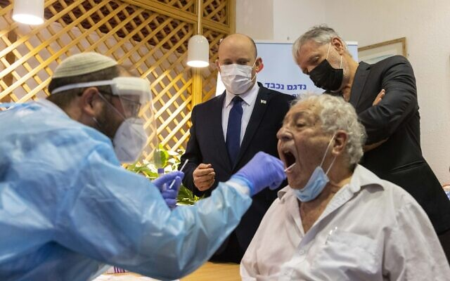 Prime Minister Naftali Bennett visits a retirement home in Jerusalem, July 27, 2021. (Olivier Fitoussi/Flash90)