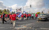 Farmers block the Bilu Junction as part of protests around the country against the finance and agriculture ministries plan to open up the fruit and vegetable market for import, on July 29, 2021. (Yossi Aloni/Flash90)