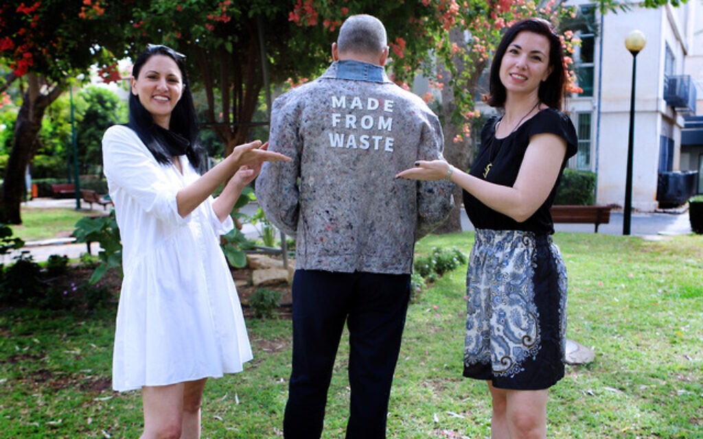 Revital Nadiv (left) and Viktoria Kanar, founders of textile innovation organization Re-Fresh Global, with designer Doron Ashkenazi jacket made from recycled fabric (Courtesy Re-Fresh Global)