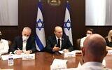 Prime Minister Naftali Bennett meets with officials at his office in Jerusalem to discuss plans for reopening of schools, July 25, 2021. (Amos Ben Gershom/GPO)