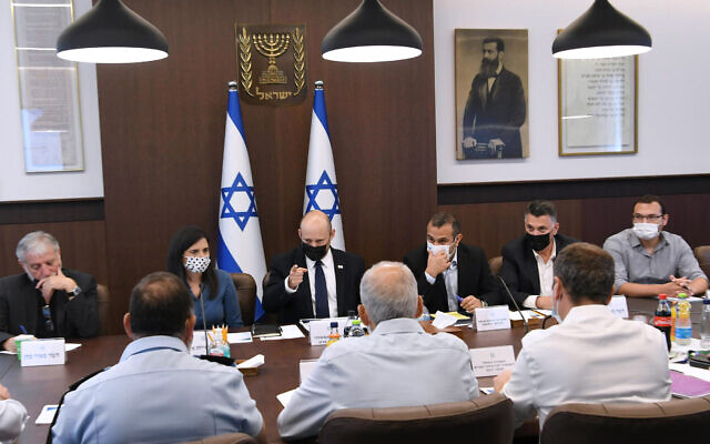 Prime Minister Naftali Bennett meets with officials to discuss plans to address violence and crime in Arab Israeli communities, at his office in Jerusalem, July 28, 2021. (Amos Ben Gershom/GPO)