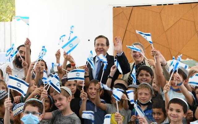 President Isaac Herzog during a visit to Lod on July 15, 2021. (Amos Ben-Gershom/GPO)