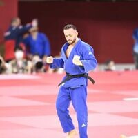 Israel's Baruch Shmailov celebrates after beating Slovenia's Adrian Gomboc to proceed to the bronze medal fight (Amit Shissel/Israeli Olympic Committee)