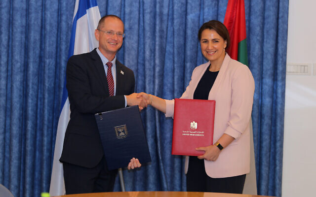 Agriculture Minister Oded Forer and UAE Minister of Food and Water Security Miriam Al-Mahiri sign a deal in Tel Aviv on July 13, 2021. (Moshe Hermon/GPO)