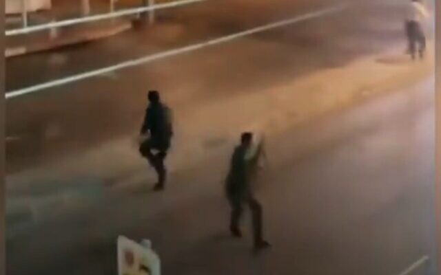 Screen capture from video of Iranian police confronting demonstrators during a protest against water shortages in Khuzestan province, July 18, 2021. (Twitter)
