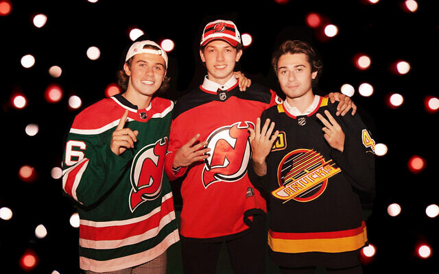 From left, the brothers Hughes: Jack, Luke and Quinn. (@_quinnhughes on Instagram; background via Getty Images, JTA)