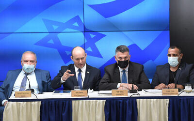 Finance Minister Avigdor Liberman, left to right, Prime Minister Naftali Bennett, Justice Minister Gideon Sa'ar and deputy minister Abir Kara present new plan to cut back Israeli red tape;  Jerusalem , July 6, 2021 (Kobi Gideon / GPO)