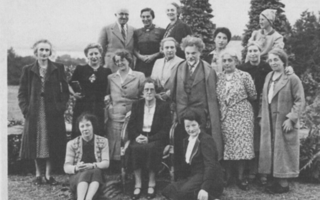 Lake District 1941: Standing behind violinist Dr. Oskar Adler, Hella Pick is the youngest in a group of refugees. (Courtesy)