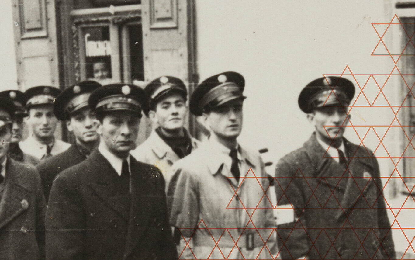 Members of the Jewish Order Service pictured in an undated photo detail from the cover of 'Warsaw Ghetto Police: The Jewish Order Service During the Nazi Occupation,' by historian Katarzyna Person. (Courtesy Cornell University Press)