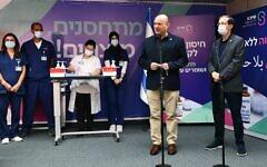 Prime Minister Naftali Bennett speaks at Sheba Medical Center at Tel Hashomer, starting the campaign for the third dose booster of the Coronavirus vaccine. (Haim Zach / GPO)