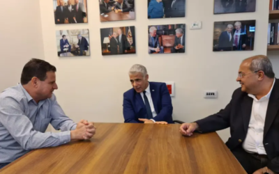 Yesh Atid leader Yair Lapid meets (center) with Joint List leaders Ayman Odeh (left) and Ahmad Tibi in the Knesset on April 19, 2021. (Courtesy)