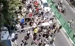 A screenshot from video of protesters marching in Tehran, Iran, on July 26, 2021. (Screen capture: Twitter)