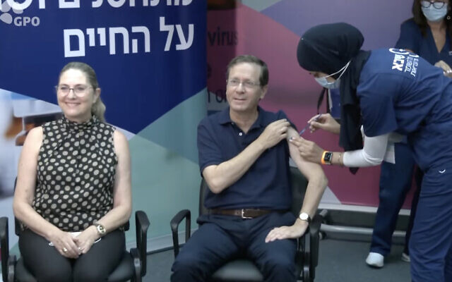 President Isaac Herzog and his wife Michal receive their third COVID-19 vaccine shots at Sheba Medical Center, July 30, 2021. (Screen capture: YouTube)