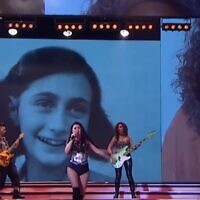 """The face of Anne Frank projected in an episode of """"Showmatch"""" in Argentina. (Screenshot from YouTube)"""