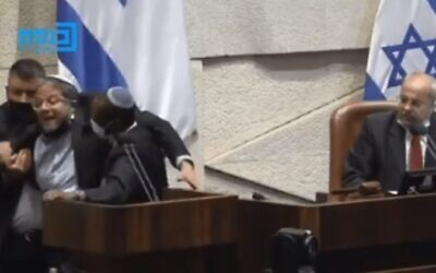 Religious Zionism MK Itamar Ben Gvir (L) forcefully removed from the Knesset podium and ejected from the plenary after called Joint List MK Ahmed Tibi (R) a 'terrorist,' July 26, 2021. (Screen capture: Knesset Channel)