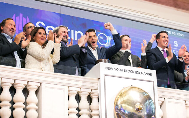 SentinelOne rings the closing bell at the New York Stock Exchange, June 30, 2021, in celebration of its initial public offering. To honor the occasion, Tomer Weingarten, SentinelOne co-founder and CEO, center with arm raised, is joined by John Tuttle, NYSE Vice Chairman and Chief Commercial Officer, second from right (NYSE)