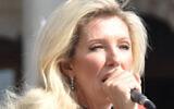 British conspiracy theorist Kate Shemirani, a former nurse, addresses a crowd of hundreds of conspiracy theorists at a rally at London's Trafalgar Square. (File: Salim Fadhley / Wikipedia)