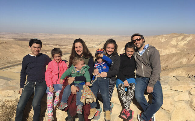 Susannah Schild with husband Avi and their six children on a hike in Israel's Negev Desert. (Courtesy)