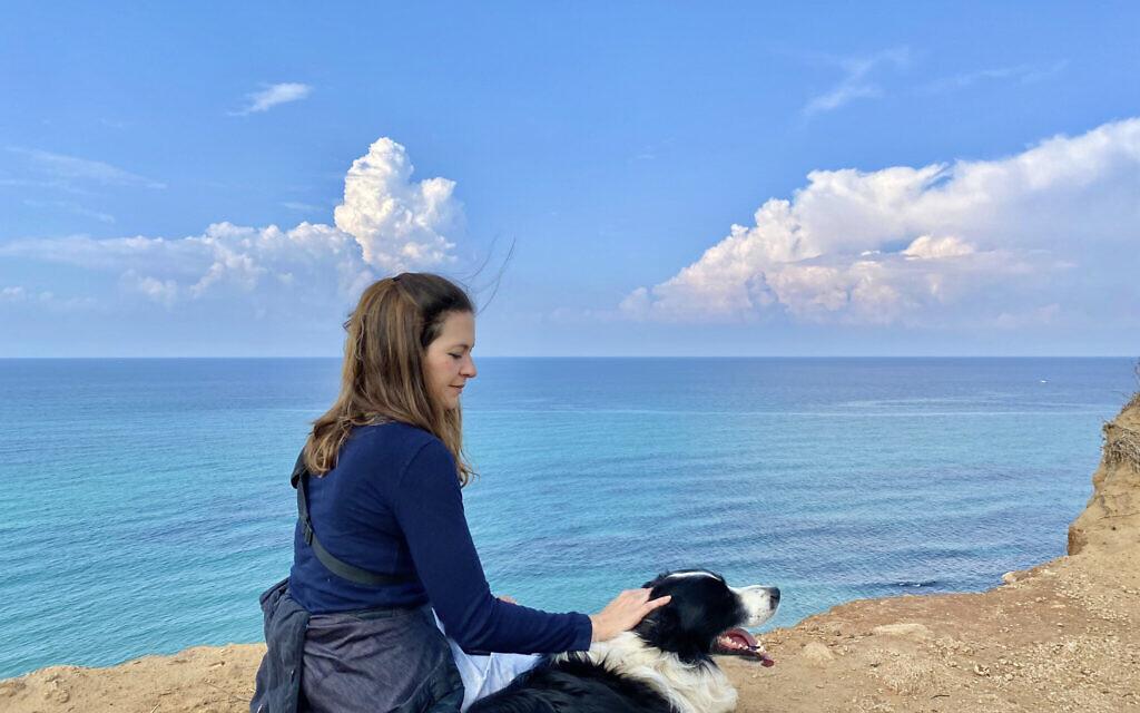 Susannah Schild and family dog Rio on a hike in the Sharon Coast region. (Courtesy)