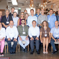 Representatives of Israeli companies selected for a Taiwanese incubator program, and representatives from the program, at an event in Tel Aviv, on July 27, 2021. (Courtesy/Nati Levi)