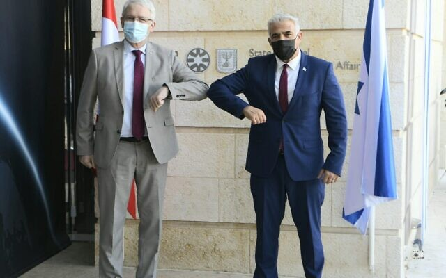 Foreign Minister Yair Lapid (right) and Canadian Foreign Minister Marc Garneau meet at the Foreign Ministry in Jerusalem on July 4, 2021. (Avi Ohayon/Foreign Ministry)
