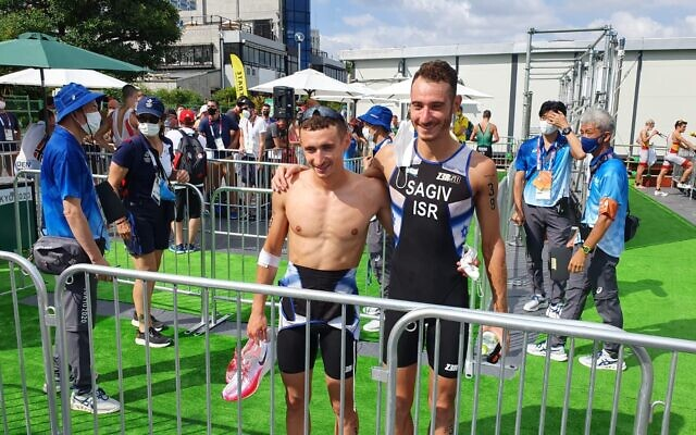 Brothers and Israeli Olympic triathletes Ran (left) and Shachar Sagiv, after the triathlon at the Tokyo Games on July 26, 2021. (Israel Olympic Committee)