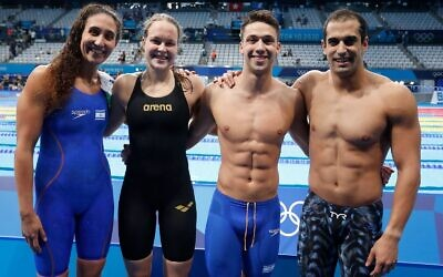 Israeli swimmers (from left) Andi Murez, Anastasia Gorbenko, Gal Cohen Groumi and Itay Goldfaden at the mixed 4x100 medley relay at the Tokyo 2020 Olympics on July 29, 2021. (Simona Castrovillari/Israel Olympic Committee)