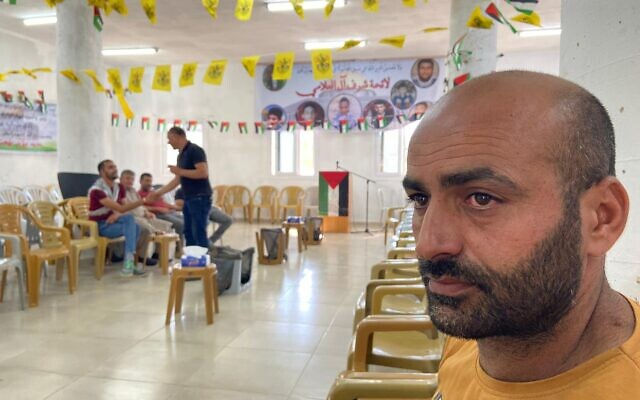 Muayyad Bahjat al-Alaama, whose son was allegedly killed after a case of mistaken identity by Israeli soldiers, at a mourning tent in his hometown of Beit Ummar in the West Bank, on Thursday, July 29, 2021 (Aaron Boxerman/The Times of Israel)