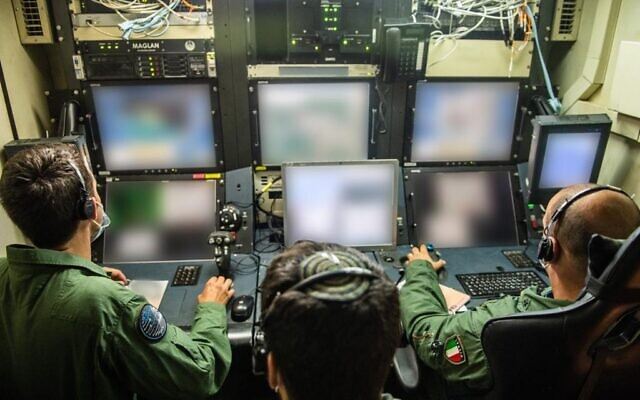 Italian drone pilots fly a Hermes-450 unmanned aerial vehicle while an Israeli operator watches during an international exercise, dubbed Blue Guardian, which launched on July 12, 2021. (Israel Defense Forces)