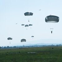 Israeli paratroopers recreate the partisans historic jump during World War II in honor of Hannah Senesh, in Slovenia, on July 20, 2021. (Israel Defense Forces)