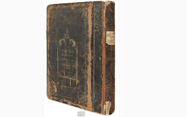 In February 2021, Kestenbaum & Company, a Brooklyn firm that has specialized in Judaica, pulled off its catalogue what the Jewish Community of Cluj says is a 19th-century ledger from its Jewish burial society. (Kestenbaum & Company via JTA)