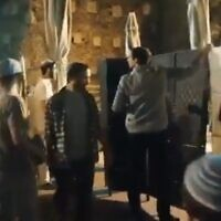 Far-right Orthodox Jewish activists install a partition to segregate men and women at the Western Wall egalitarian prayer plaza in Jerusalem during a Tisha B'Av prayer service on July 17, 2021 (Screencapture/Twitter)