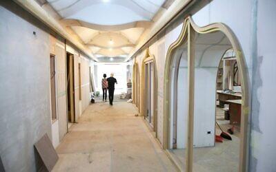 NaTang, left, and Jeffrey D. Schwartz in Taiwan's new Jewish community center, currently under construction. (Glenn Leibowitz)