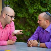 Political adviser Moshe Klughaft (L) with then-Jewish Home leader Naftali Bennett in 2013 (Eric Sultan/Klughaft.com)