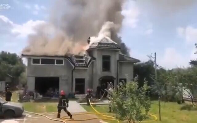 The scene of a fire in Sheparivtsi, Ukraine after a plane crashed into a house, on July 28, 2021. (Screenshot/YouTube)