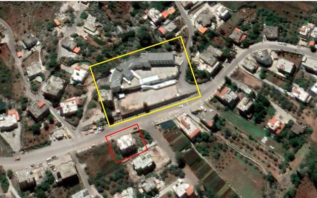 An alleged Hezbollah weapons depot (outlined in red) is seen across the street from a school (outlined in yellow) in the central Lebanese town of Ebba in a satellite image from June 1, 2020. (Google Earth, outlines added by The Times of Israel)