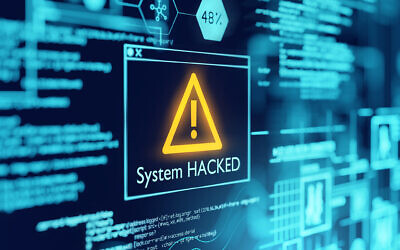 An illustrative image of computer popup box screen warning of a system being hacked; hackers, cybersecurity attack (solarseven; iStock by Getty Images)