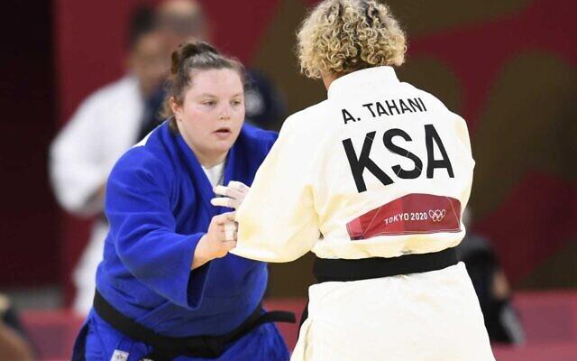 Saudi Arabia's judoka Tahani Alqahtani faces off against Israel's Raz Hershko, at the Tokyo 2020 Olympic Games, on July 30, 2021. (Israel Olympic Committee)