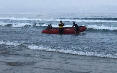 Fire and Rescue Services volunteers search for a 10-year-old boy who went missing at sea near Acre, July 25, 2021. (Fire and Rescue Services)